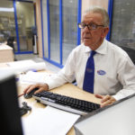 Executive assistant Rebellato, 68, works on a spreadsheet as he works at his desk at Pimlico Plumbers in London